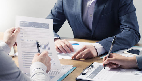 41135194 - financial service professional team at work, hands close with business reports and paperwork