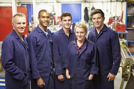 31009917 - portrait of staff standing in engineering factory